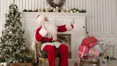 Santa Claus taking merry selfies on his phone Stock Footage