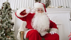 Santa Claus showing a victory sign with both hands Stock Footage