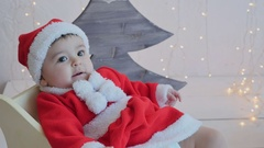 Little baby 5 months in a Santa Claus costume Stock Footage