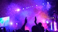 Human silhouettes applauding, watching amazing colorful light and confetti show HD Footage