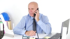 Businessman Engineer Write Working Schedule and Talk with Employees Using Phone. Stock Footage