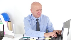 Building Designer Smile Reading Good News on Laptop and Make Happy Gestures. Stock Footage