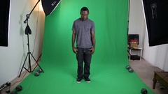 Attractive African American Male Acting on Studio Green Screen Stock Footage