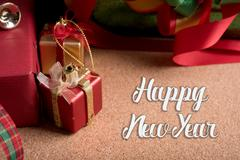 Gifts box and holiday decoration on wood table with word happy new year Stock Photos