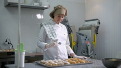 Professional confectionery sprinkled with powdered sugar freshly baked eclair in Stock Footage