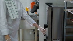 The woman in a candy store. The girl in a white form and colourless gloves and Stock Footage