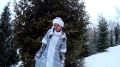 Snow Maiden in forest smiling dancing in front of pine tree Stock Footage