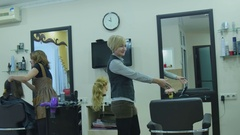 Hairdressers work in a beauty salon Stock Footage
