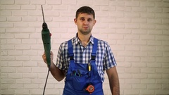 A man with a perforator. Master builder, repairman tool. Stock Footage