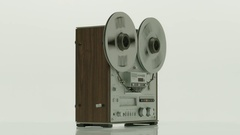 Old reel tape recorder with spinning reels on white background. Stock Footage