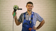 A man with an angle grinder. Man holds in his hand electric tool. Stock Footage