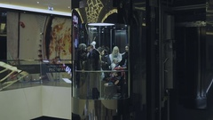 People go on the elevator at the mall Stock Footage