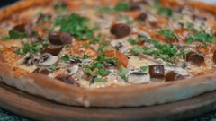Pizza on a Wooden Platter in the Pizzeria Stock Footage