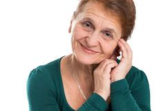 Portrait of a happy old woman on a white background Stock Photos