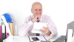 Businessman Smiling Use Tablet and Receive Financial Good News Reading Email. Stock Footage