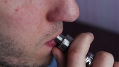 Man smoking electronic cigarette vapor Stock Footage