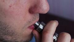 Man smoking electronic cigarette vapor Stock Footage