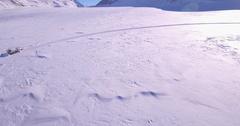 Snow groomer rotation - Aerial 4K Stock Footage