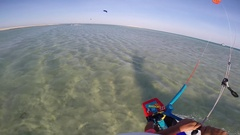 POV of a young man kite surfing on a sunny day in Egypt, slow motion. Stock Footage
