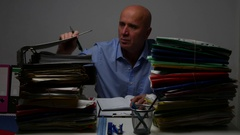 Manager Routine Work in Office Selecting Files Order and Notes Them in Agenda.  Stock Footage