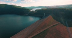camera flying over the water oasis towards the mountains and the river as the s Stock Footage