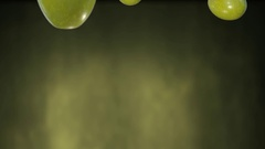 Olives falling with green background Stock Footage