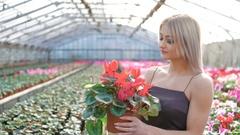 Pretty blonde smelling flowers 4K Stock Footage