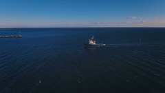 The towboat returned to port after sending a big cargo ship. Aerial shooting. 4K Stock Footage