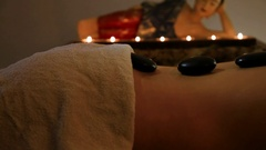 Adult Woman Having Hot Stone Massage in Spa Salon Stock Footage