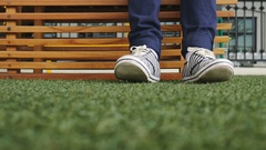 Female feet in jeans and sports shoes Stock Footage