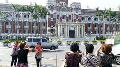 People pose for the Presidential Office Building in Taipei Stock Footage