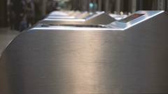 Turnstiles of a station with people in the background Stock Footage