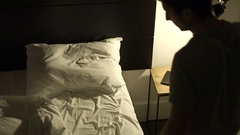 Person goes to bed with his mobile phone in bed Man lays down in bed Stock Footage
