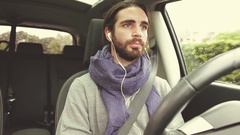 Handsome man driving car talking on cell phone smiling happy retro style Stock Footage