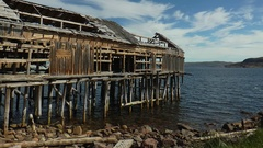 Dilapidated fishing wooden warehouse on the seashore. Stock Footage