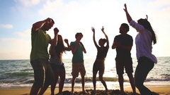 Multiracial group of friends having a party at beach Stock Footage