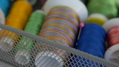 4K : Zoom in shot of colorful spools of thread in textile factory Stock Footage