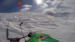 POV of a man snow kiting on a snow covered mountain, slow motion. Stock Footage