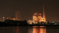 4k Time-lapse of electrical power plant near the sea coat at night Stock Footage