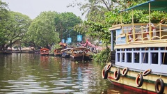 Indian Tourist Boats Roll on Wide River against Trees Stock Footage
