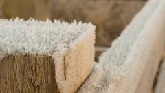 Frost covered fence post with visible ice crystals in winter Stock Footage