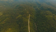 Aerial view road in the jungle mountains. Camiguin island Philippines Stock Footage