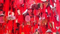 The temple trees, hanging a lot of people's wishes and blessings hang red paper Stock Footage