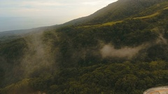 Aerial view evening rainforest. Camiguin island Philippines Stock Footage