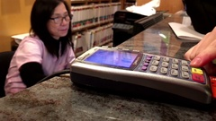Motion of woman paying dental fee by credit card  inside dental clinic Stock Footage