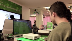 People playing new xbox game at Microsoft store in Burnaby BC Canada Stock Footage