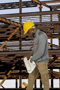 Black Construction Worker with Blueprints Stock Photos
