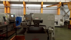 Manufacturing machines in a factory, aerial footage Stock Footage