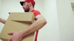 Happy man delivering parcel boxes to customer home Stock Footage