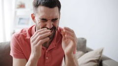 Man suffering from headache at home Stock Footage